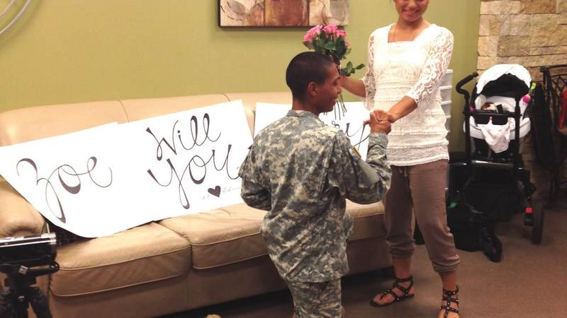 Pvt. Emmanuel Aleman proposes to Pvt. Zoe Tunchez at the USO San Antonio airport center.