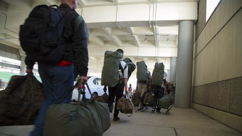 Marines carry their bags to busses headed to Camp Lejeune, North Carolina, on March 9. The Marines had spent the afternoon at the USO center inside Raleigh-Durham International Airport.