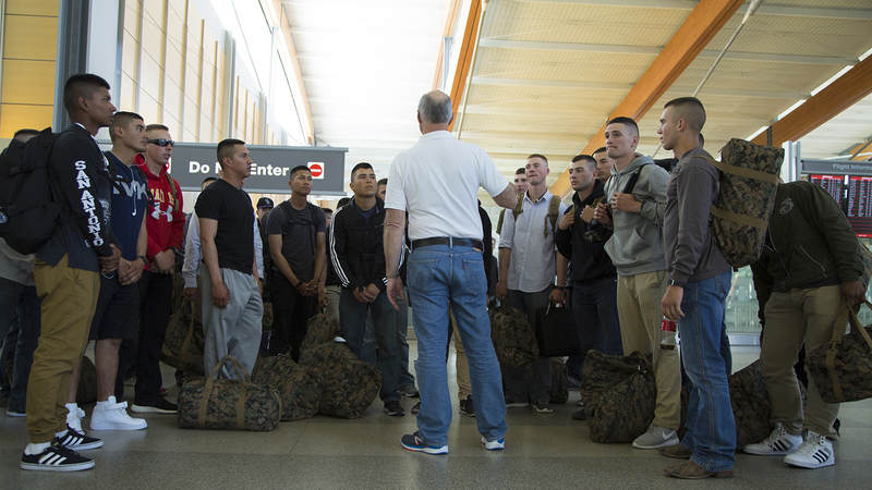 USO of North Carolina volunteer JC Cunningham briefs Marines on March 9 at Raleigh-Durham International Airport. The USO helps coordinate the Marines' transportation from the airport to Camp Lejeune, North Carolina.