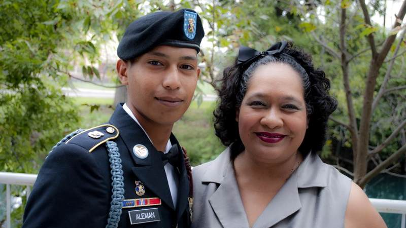 Pvt. Emmanuel Aleman poses with his mother Marita Maldonado.