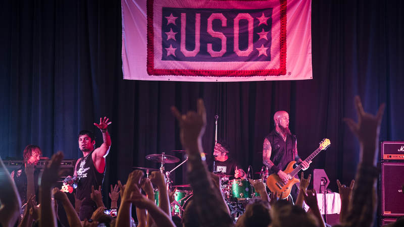 The service members of Malmstrom AFB in Montana salute Drowning Pool as they perform Sept. 13, 2013.
