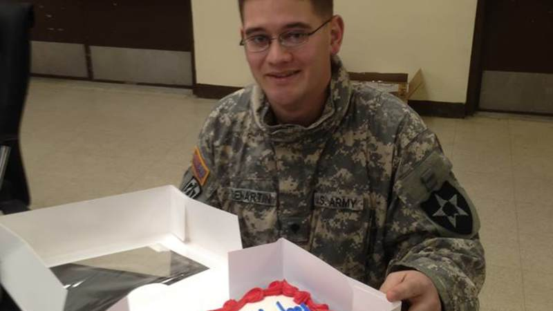A soldier shows off his birthday cake at Camp Casey, South Korea.