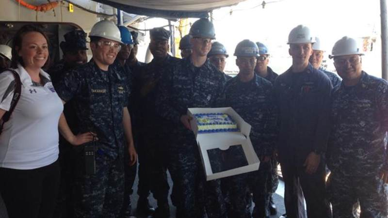 Sailors show off a birthday cake in Japan.
