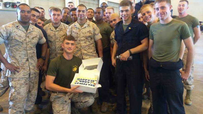 A Marine displays his birthday cake delivered by USO Okinawa.