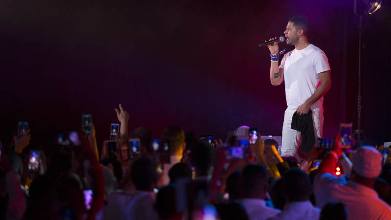 """""""Empire"""" star Jussie Smollett performs for fans during a USO show at Yokota Air Base, Japan, in December 2015."""