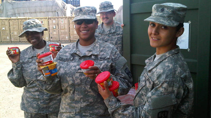 Soldiers pick up snacks donated by USO at Camp Buchanan, Liberia.