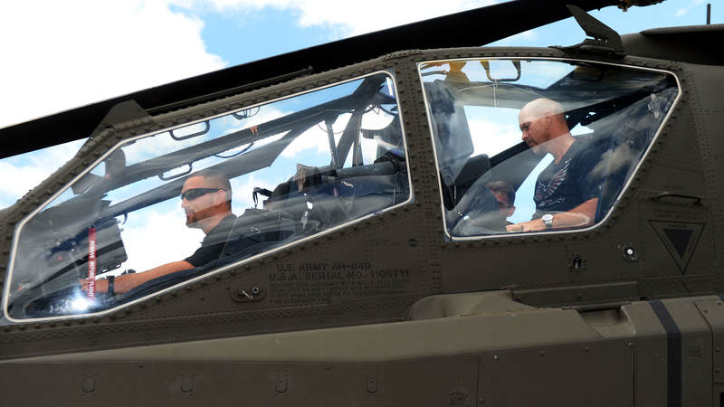 Atlanta Falcons linebacker Paul Worrilow, left and kicker Matt Bryant get an up-close look inside an Army Apache helicopter during a weeklong USO/NFL tour to Guam and Hawaii.