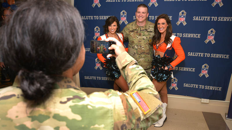 The USO opened its latest Military Entrance Processing Station location on Tuesday in Denver with help from the Super Bowl Champions. The event -- in coordination with the NFL's Salute to Service campaign -- included a meet-and-greet with former Denver Broncos players and Broncos cheerleaders and a tailgate lunch.