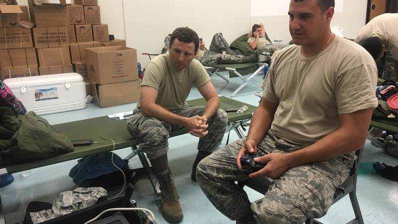 Louisiana National Guardsmen enjoy playing one of 18 Mobile Entertainment Gaming Systems (MEGS) sent to service members assisting with the flood cleanup near Baton Rouge. Packaged in small, rugged containers, MEGS provides instant entertainment options to service members in remote locations. Within minutes of receiving MEGS, troops can be watching a movie or playing a video game, bringing them a true comfort from home.