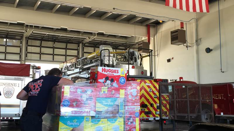 Gulfport Fire Department sorts relief supplies from the USO Gulf Coast supply drive for flood victims in Louisiana.