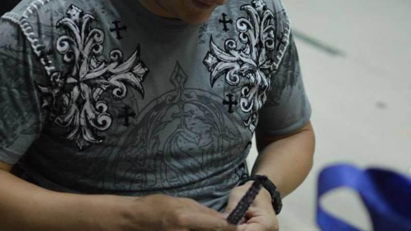 A service member braids.