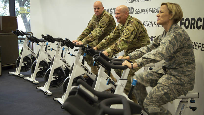 Service members exercise at the new USO wellness center on Joint Base San Antonio.