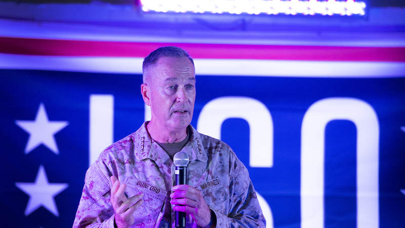 Marine Gen. Joseph Dunford, the chairman of the Joint Chiefs of Staff, speaks to the crowd before the USO show at Al Udeid Airbase in Qatar.