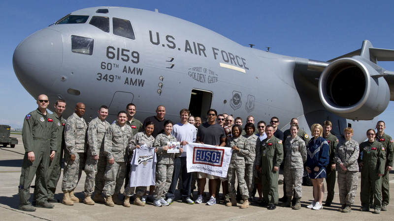 (L-R) Billy Miller, Drew Brees and Donnie Edwards pose in front of a U. S. Air Force C-17 aircraft with members of the 38th Aerial Expeditionary Group at Incirlik Air Base, Turkey, March 24, 2010. On a mission to boost morale and bring a touch of home to troops the trio recently took part in their third USO tour together.