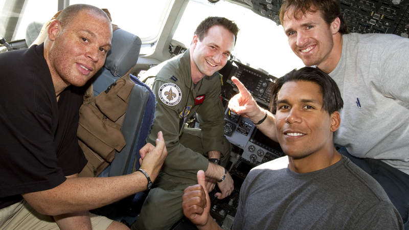 (L-R) Billy Miller, Donnie Edwards and Drew Brees pose in the cockpit of a U. S. Air Force C-17 aircraft with U. S. Air Force Captain Stacey Miller of Chicago, IL. at Incirlik Air Base, Turkey, March 24, 2010.