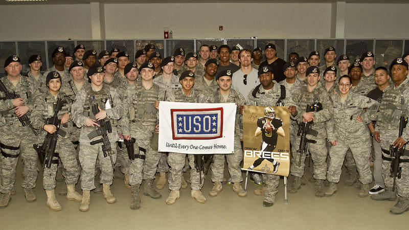 Drew Brees (center), NFL veteran Donnie Edwards (left of Brees) and Saints tight end Billy Miller (right of Brees) poses with members of the 39th Security Squadron at Incirlik Air Base, Turkey, March 24, 2010.