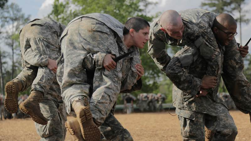In 2016, Capt. Kristen Griest, center, became the first female Army infantry officer in the nation's history. A year earlier, Griest and Lt. Shaye Haver (not pictured) were also the first women to graduate from the Army's famed Ranger School.