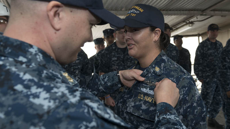 """Chief Petty Officer Dominique Saavedra became the first female enlisted sailor to earn her submarine qualification, or """"dolphins,""""marking a major milestone for female sailors."""
