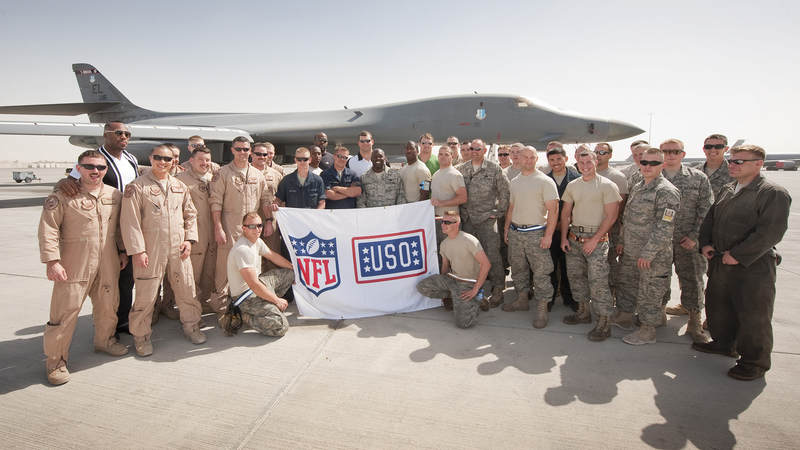NFL players Vernon Davis-San Francisco 49ers (L), Mario Williams-Houston Texans (L-middle),  Joe Thomas-Cleveland Brown (R-middle) and Jason Witten-Dallas Cowboys (R) pose for a photo with the crew of the B-i Bombers, March 3, 2010.  The 2010 NFL All Stars are traveling on an eight-day, nine-base trek through the Persian Gulf on a mission to boost morale and extend their thanks to America's troops.