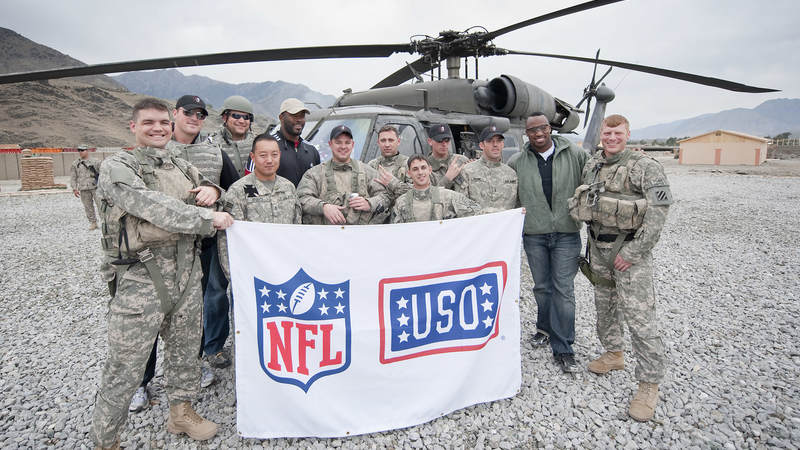 NFL All-Stars (L-R) Dallas Cowboys Jason Witten, Cleveland Browns Joe Thomas, Houston Texans Mario Williams and San Francisco 49ers Vernon Davis pose with troops, March 6, 2010. The four players recently took part in their first USO tour.