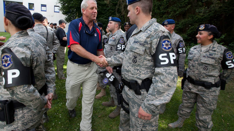 Carolina Panthers head coach John Fox visits with MP's at Kaiserslautern Air Base in Germany during a USO/Armed Forces Entertainment tour stop on June 30, 2010.