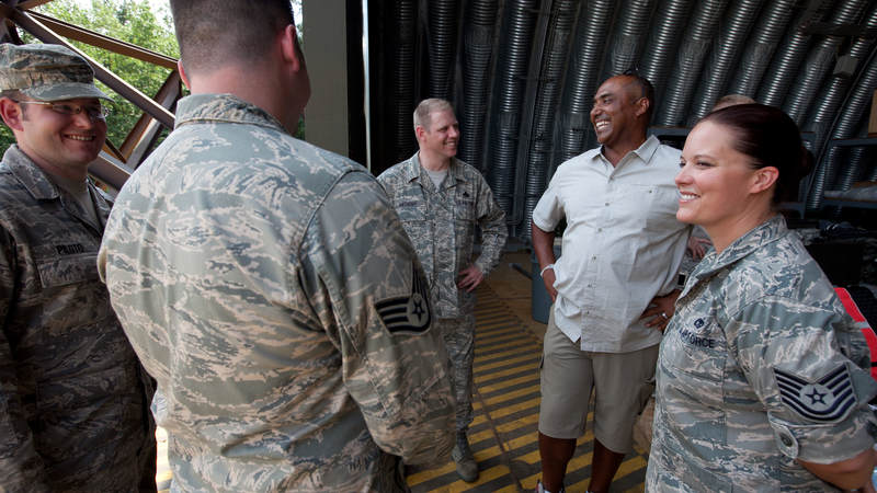 Cincinnati Bengals head coach Marvin Lewis (2nd r) talks with airmen at the 435th Air Mobility Squadron at Ramstein Air Base in Germany on June 30, 2010.