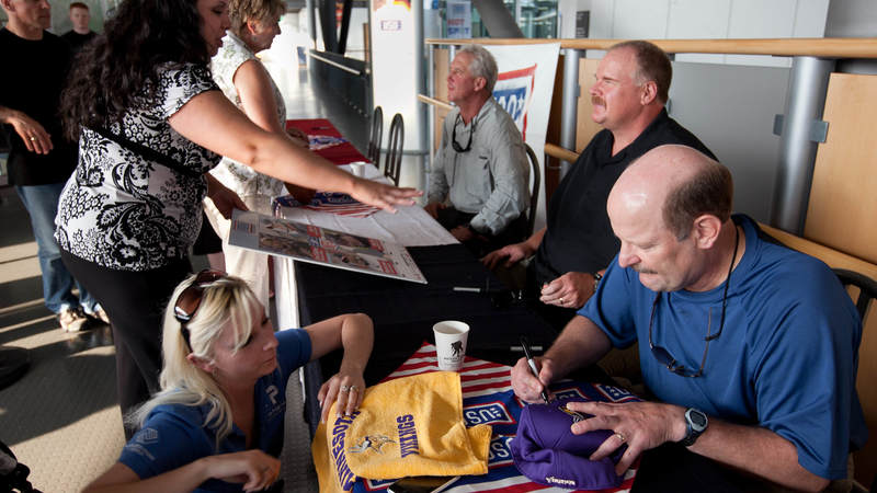 (r-l) Minnesota Vikings head coach Brad Childress, Philadelphia Eagles head coach Andy Reid and Carolina Panthers head coach John Fox sign autographs and visit with troops and their families at the USO center in the Ramstein Passenger Terminal at Ramstein Air Base in Germany, June 29, 2010.