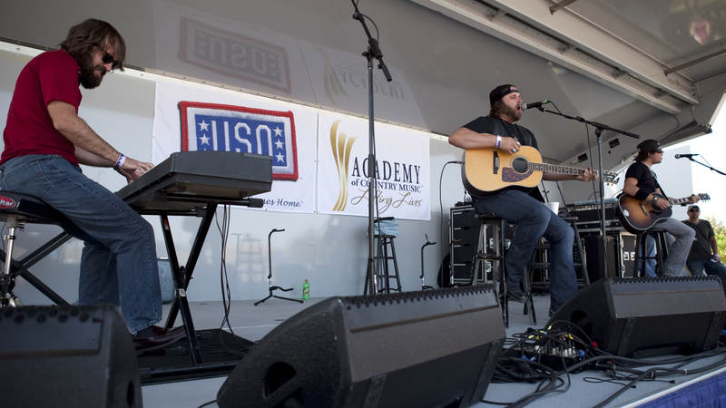 Country music artist Randy Houser performs with his band during the USO/ACM Lifting Lives concert at Nellis Air Force Base in Las Vegas on April 17, 2010.