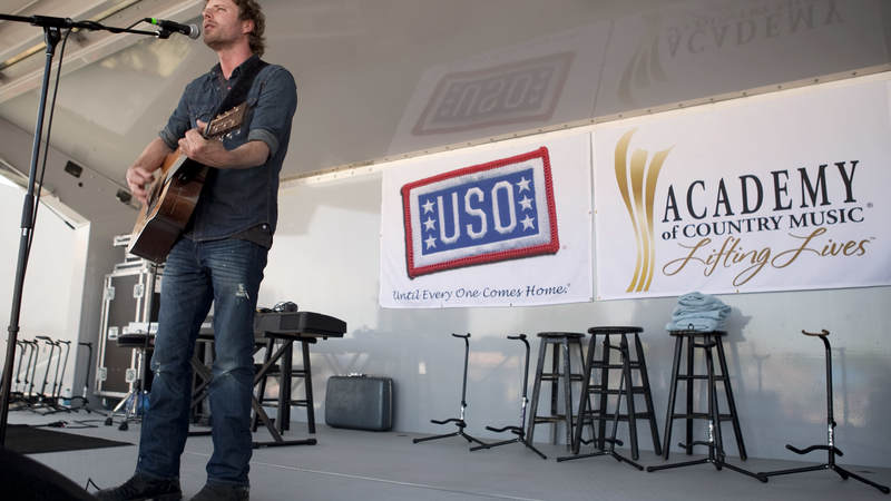 Country music artist Dierks Bentley performs during the USO/ACM Lifting Lives concert at Nellis Air Force Base in Las Vegas, NV, April 17, 2010.