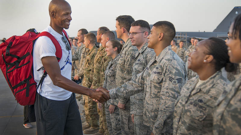 Ten-time NBA All-Star Ray Allen shakes hands with service members stationed in Qatar during the USO Chairman's Holiday Tour in December.