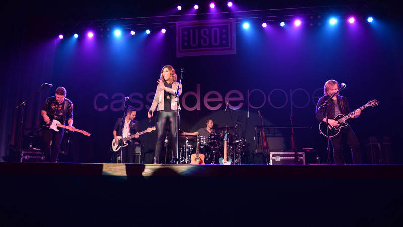 Cassadee Pope enters the stage at the Ernie Walker Theater April 8,  on Eielson Air Force Base, Alaska.