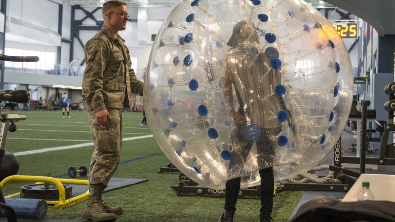 Air Force Airman Anthony Anderson, a 354th Force Support Squadron fitness specialist, explains how to use a knocker ball to Cassadee Pope April 8 at Eielson Air Force Base, Alaska.