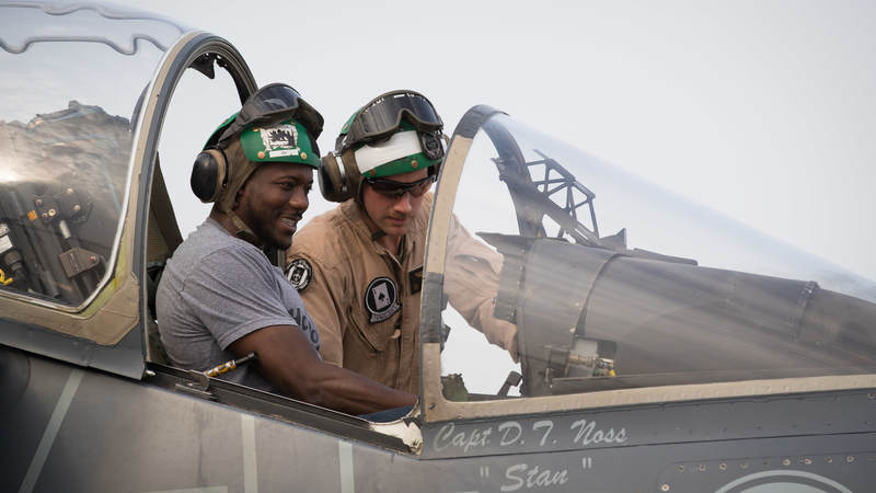 Miami Dolphins cornerback Byron Maxwell gets to sit in the cockpit of a Marine Corps Harrier Jet while being given a tour of the plane as part of a USO tour stop in the U.S. Fifth Fleet Area of Operations on April 8.