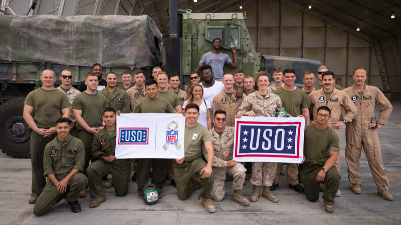 New Orleans Saints defensive end Cameron Jordan, Tennessee Titans tight end Delanie Walker and Miami Dolphins cornerback Byron Maxwell pose for a photo with service members during a USO tour visit in the U.S. Fifth Fleet Area of Operations April 8.