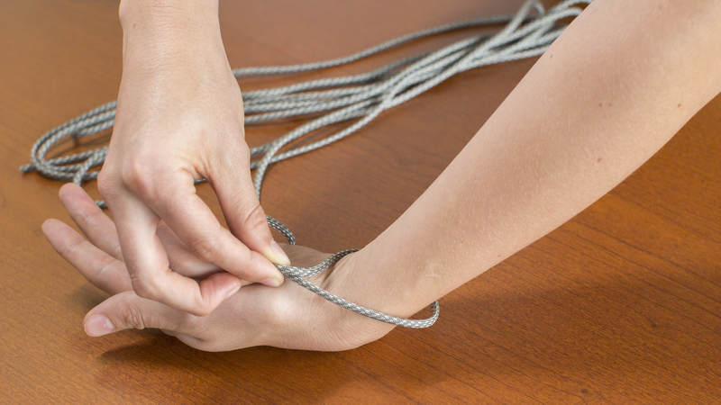 1. Measure your wrist with the cord.