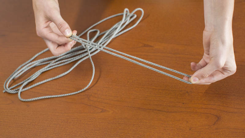 3. Fold the piece of cord in half.