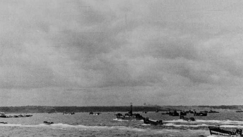 Landing craft filled with assault troops approach Omaha Beach, comprising the first wave to set foot on French soil.