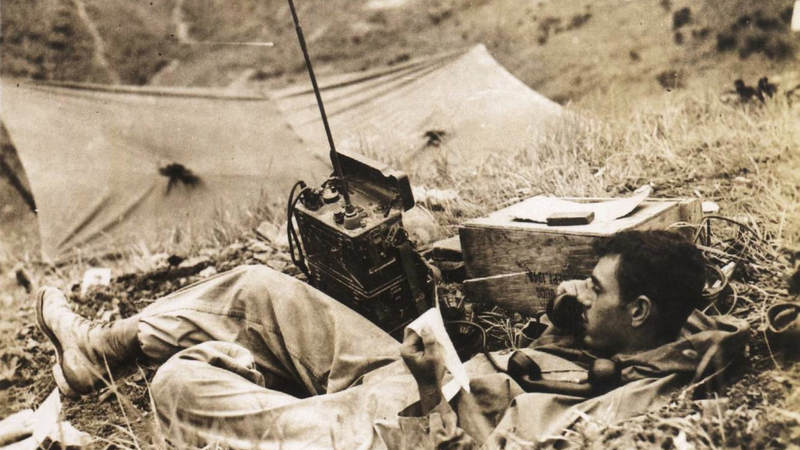 A 2nd Infantry Division soldier talks on the radio, circa September 1950. During the second series of Naktong River battles, which occurred during the first two weeks of September 1950, many U.S. Army units found themselves surrounded by the enemy, with all communications cut off.