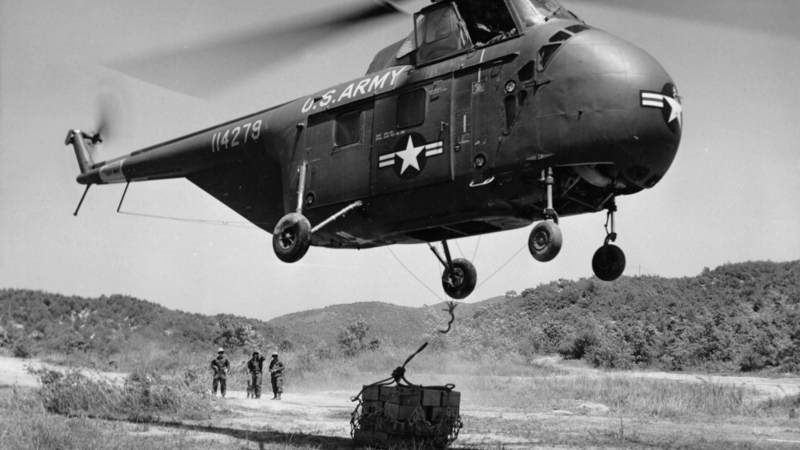 A U.S. helicopter delivers C-rations to the 25th U.S. Infantry Division's 35th Infantry Regiment near Panmunjom, Korea, May 23, 1953.
