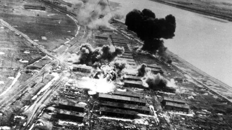 B-26s bomb an enemy storage and barracks area in February 1951. In the upper left corner is a B-26 starting its bomb run.