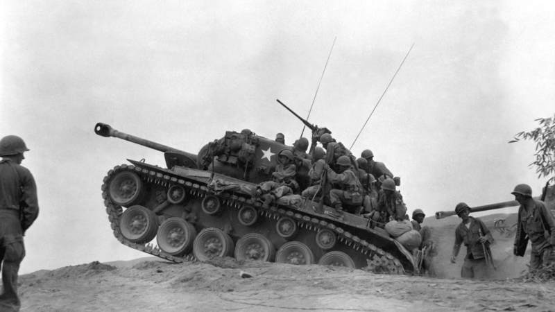 Soldiers, from the 9th Infantry Regiment, 2nd Infantry Division, ride on an M26 Pershing Tank in Korea, in September 1950. In a series of bloody clashes along the Naktong River that month, tanks proved critical for the undermanned American forces.