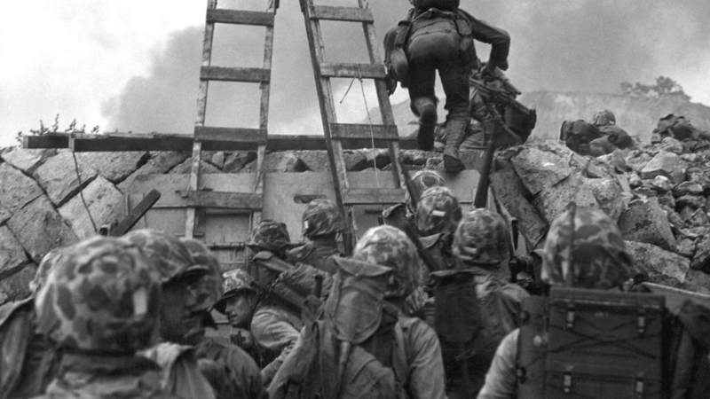 U.S. Marines use scaling ladders as they assault North Korean positions at Inchon in South Korea on Sept. 15, 1950.