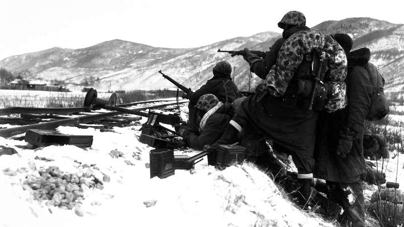First Division Marines counter fire with fire when attacked by entrenched Chinese forces during the division's heroic breakout from Chosin.