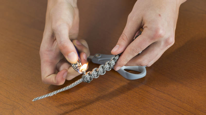 12. Using a lighter, melt both of cut ends to secure the braid you just crafted.