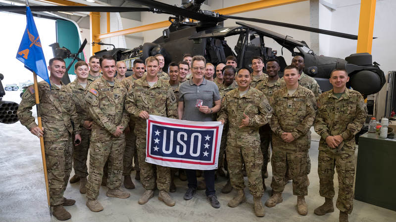 "Thousands of service members and military family members turned out to meet Bryan Cranston, an award-winning actor, screenwriter, director and producer who brought his best-selling ""A Life in Parts"" memoir to life in an intimate theater show during a USO tour across Europe."