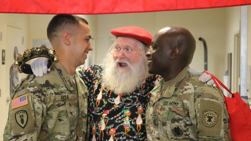 USO volunteers and staff joined Santa on a journey around the Denver area, bringing small gifts and gigantic smiles along with them.