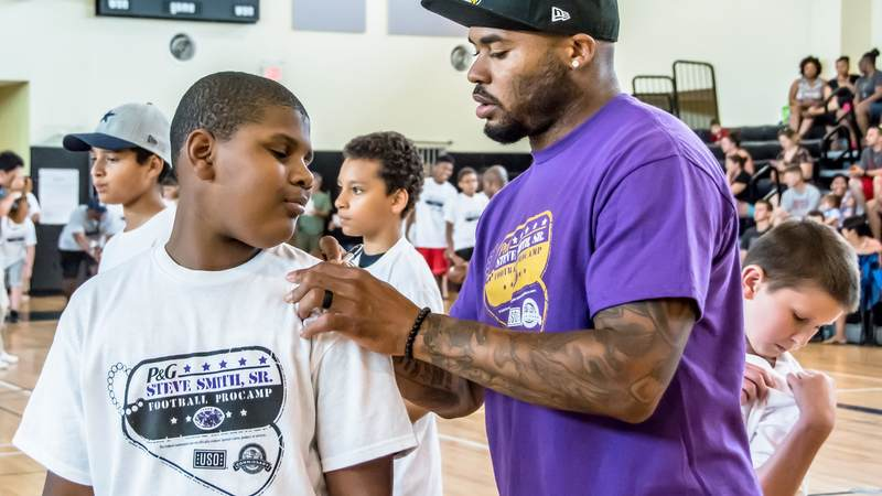 Military kids enjoyed Football ProCamp at USO Humphreys with former NFL player Steve Smith Sr.