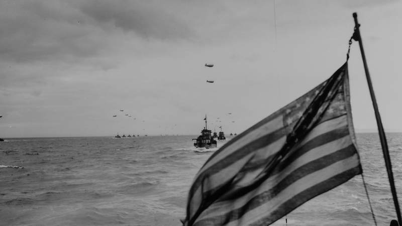 Columns of Coast Guard LCIs, protected by barrage balloons against low-flying Nazi strafers, advance upon the beaches of France. A Coast Guard combat photographer, going into the invasion on an LCI, caught this picture of the advance guard of the Liberation Fleet in the English Channel. 1944