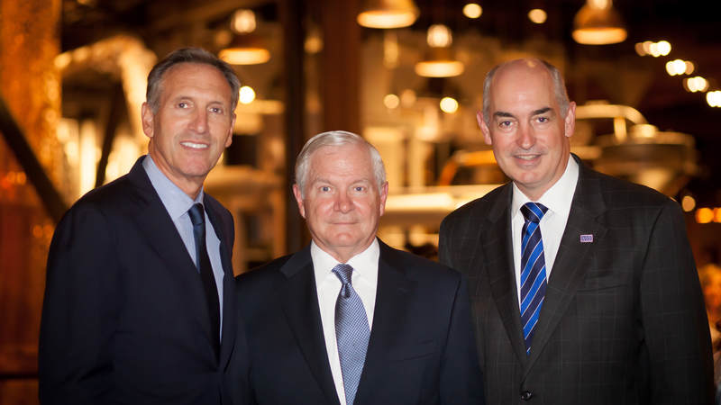 Howard Schultz, Starbucks chairman and CEO, Robert Gates, Former Defense Secretary, and Dr. JD Crouch II, USO president and CEO, come together to discuss bridging the military – civilian drift at the Starbucks hosted Muster.