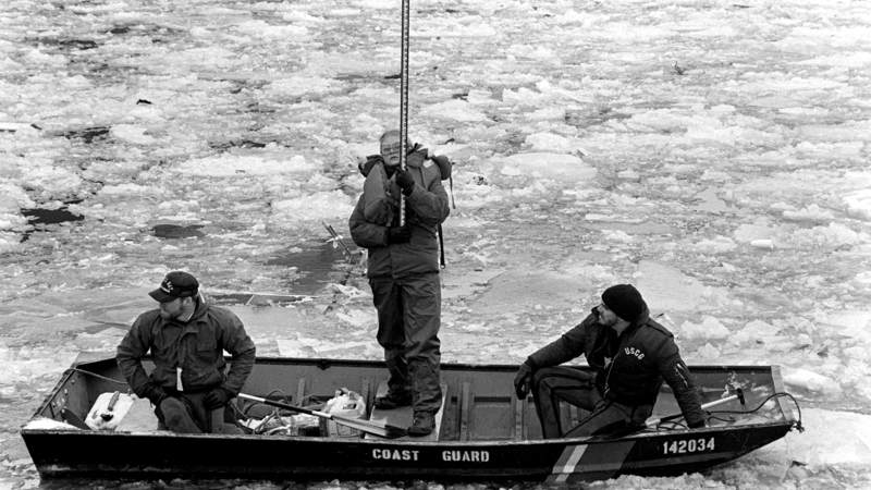 Members of the U.S. Coast Guard assist a survey team in plotting the wreckage from Flight 90, the Air Florida Boeing 737 that crashed into Washington's 14th Street Bridge in 1982.